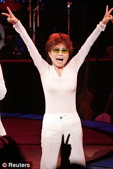 Lone voice: Yoko Ono flashes two peace signs during a curtain call after the premiere of the Broadway musical Lennon in 2005