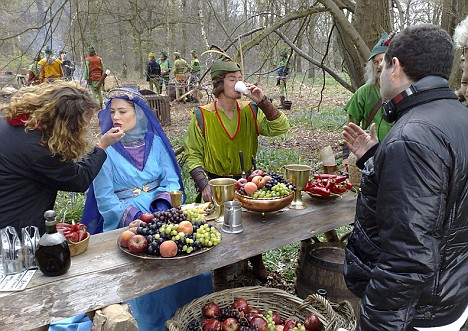 Lucy's make-up is retouched as she sits on the set of Cineman. She appears to be dressed as Maid Marian next to a character dressed as Robin Hood