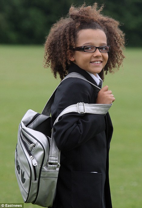 Back to school: Perry Kiely, 13, returned to Gable Hall School in Stanford-le-Hope, Essex on Wednesday