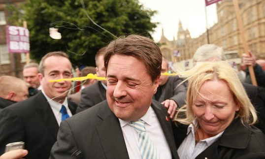A smashed egg can be seen flying behind Nick Griffin