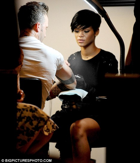 Hard at work: Rihanna had a lesson in tattooing at East Side Ink in New York
