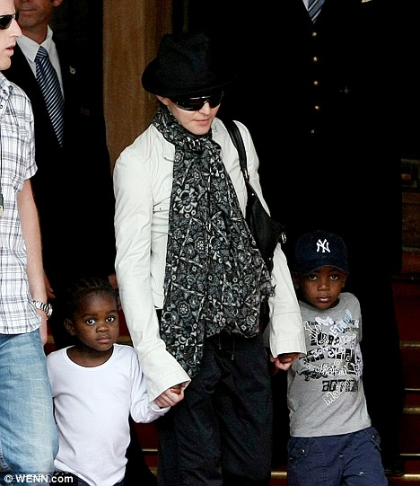 Madonna leaving the Ritz Carlton hotel with Mercy and David on Friday