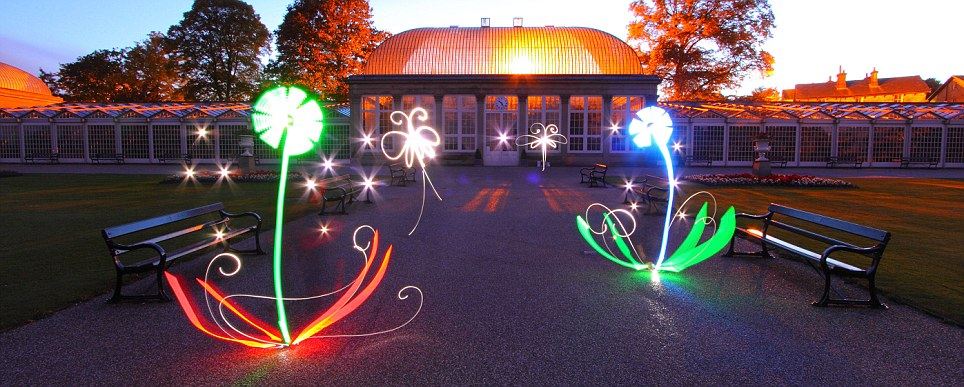 Here, he creates flowers in the Botanical Gardens using just torches and a long exposure.