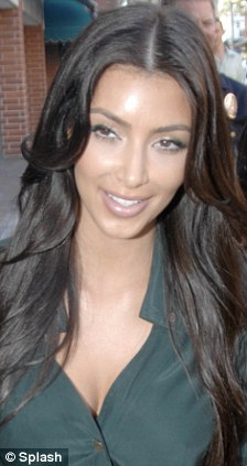 kim kardashian goes back to her roots as she ditches blonde hair for brunette look daily mail