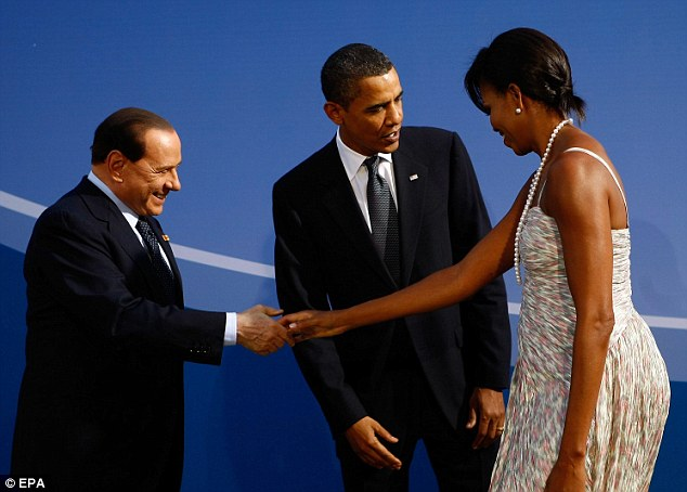 Image from Daily Mail, UK of Michelle Obama snubbing Berlusoni with a cold handshake.