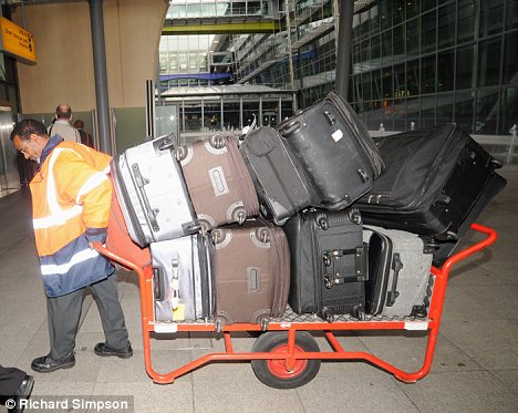 Whitney Houstons belongings: All 9 stuffed suitcases of it!