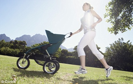 Woman running with her baby in a pram (file picture)