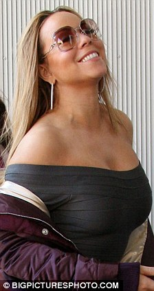 Mariah Carey nearly falls out of her top as she celebrates success of new movie  Daily Mail Online