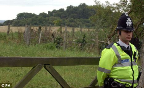 Suicide?: A police officer stands next to a cordon near Harrowdown Hill in Oxfordshire where Dr David Kelly's body was found in July, 2003