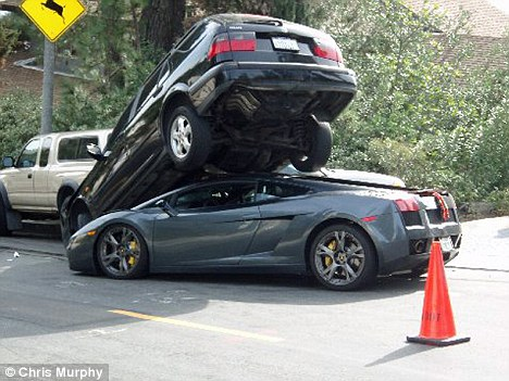 Stuck: A Lamborghini Gallardo somehow slotted under a Sabb 4x4