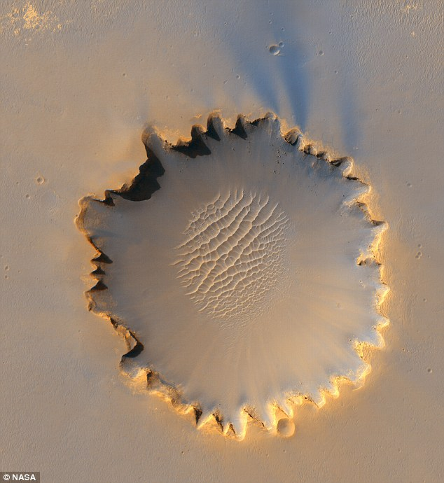 Jagged edge: The rim of Victoria Crater, home to a field of sand dunes, was caused by erosion