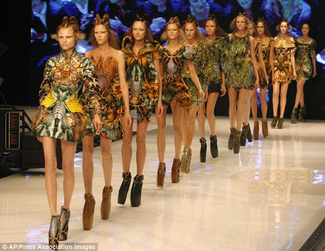 Fantasy fashion: Last September McQueen sent models down the catwalk in towering 12-inch boots for an ethereal show inspired by Charles Darwin's The Origin Of The Species