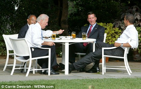 Obama (right) at the so-called 'Beer Summit' with (from left) Harvard Professor Henry Gates, U.S. Vice President Joe Biden and Police Sgt James Crowley. The summit was called after Crowley arrested Gates at his home on July 16, sparking racial tensions