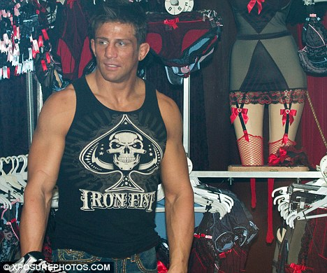 Underwear: Alex Reid - who is known to have a penchant for cross-dressing - appeared perfectly comfortable in the lingerie store