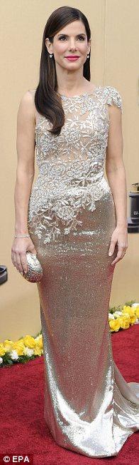 Best Actress Sandra Bullock shimmered in British label Marchesa
