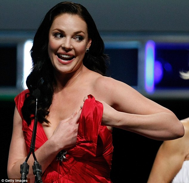 Embarrassment: Katherine Heigl struggles to keep her broken strap 