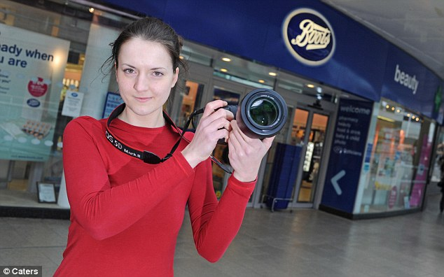Photography student Joanna Ornowska outside Boots in Coventry's  Lower Precinct shopping centre