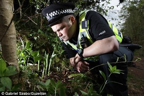 Plant patrol: PC Tony Marsh keeps a close eye on the lady's slipper orchid
