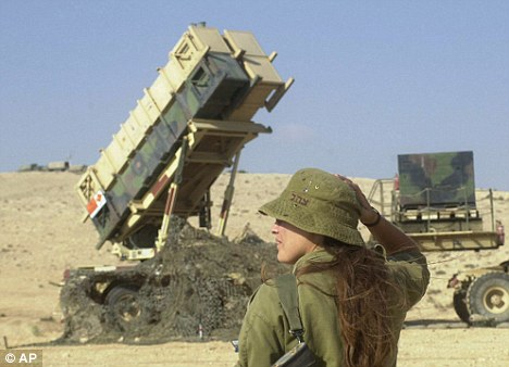 An Israeli soldier walks toward a unit of recently deployed Patriot missiles near the Dimona reactor (file photo)