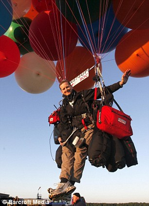 Adventurer Jonathan Trappe crosses Channel in chair tied