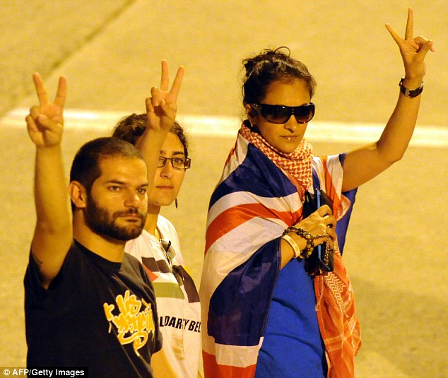 Belgian activist Isnasni Kenza, centre, and British nationals arriving in Istanbul after being deported by Israel