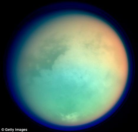 Saturn's moon, Titan, pictured using ultraviolet and infrared cameras on board the space probe Cassini. Scientists now believe that the moon could harbour life