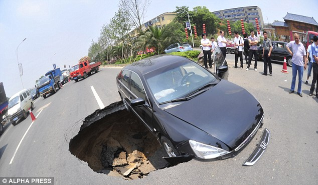 Trapped: The vehicle is stuck after a sinkhole opened up in Nanchang City