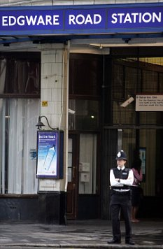 Police at Edgware Road Station a year after the suicide bombings which claimed the lives of 52 people