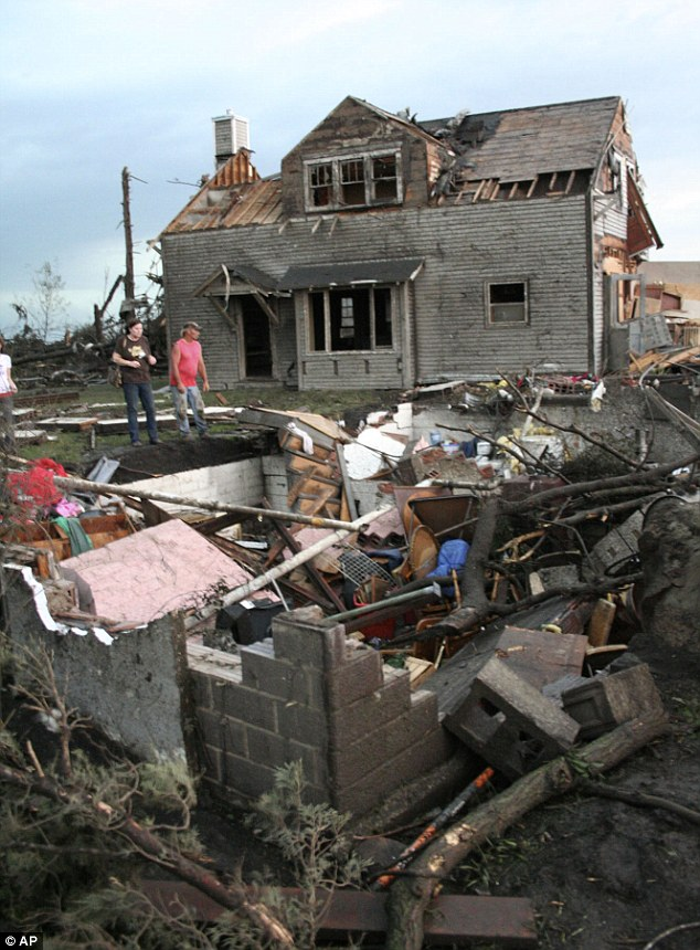 At least two people were killed and dozens more injured as tornadoes ripped