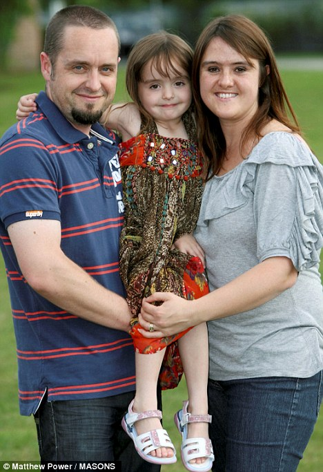 Family: Cheryl with husband James and daughter Scarlett. Cheryl experienced severe morning sickness when she was pregnant with Scarlett but it was even worse with the next pregnancy