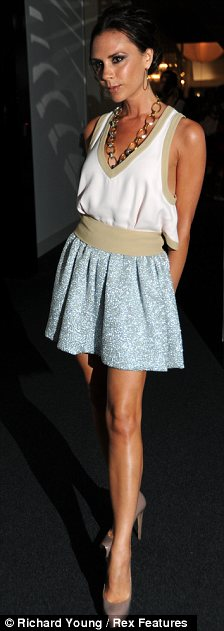 Won't be a late one: A fresher-faced looking Posh arrives at the Net-A-Porter party at the Westfield Shopping Centre