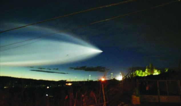 Another photo from a different angle which shows a wide trail behind the object as it zips through the sky