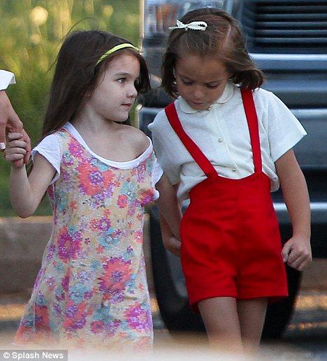 Suri Cruise latches onto Katie Holmes on screen daughter