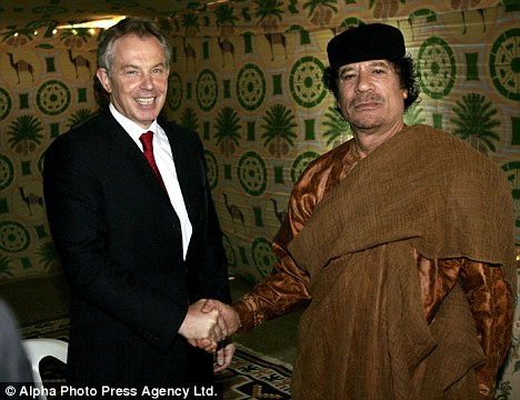 Meeting: Tony Blair shakes hand with Libyan leader Colonel Gaddafi