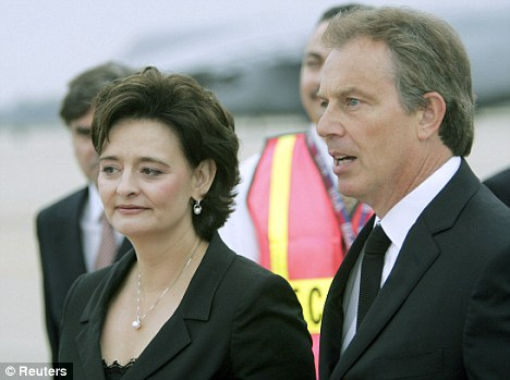 Power couple: Tony Blair and his wife Cherie on a visit to the U.S. when he was Prime Minister. Since leaving office their wealth has increased hugely