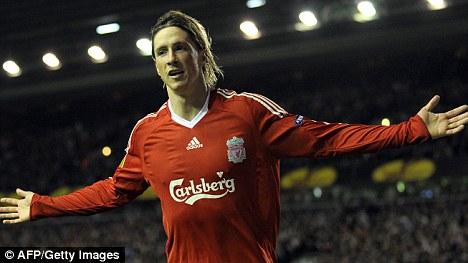 Relief: Liverpool fans kommer att vara mycket nöjd med nyheten stjärna anfallaren Torres är att stanna