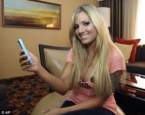 Adult film star Teagan Presley poses with her iPhone in Atlanta. Presley is experimenting with Apple's FaceTime feature