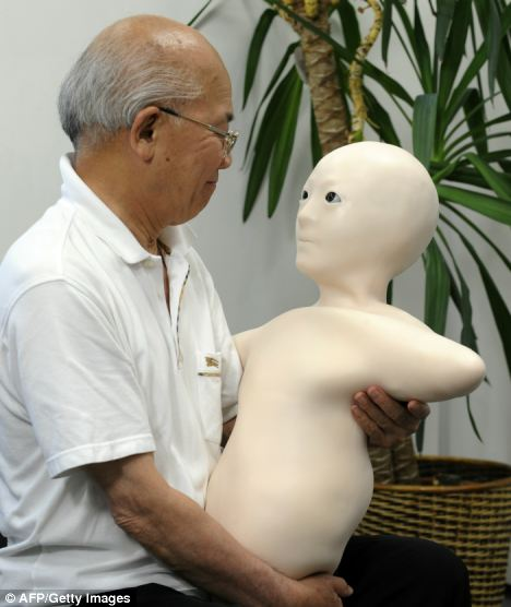 An elderly man communicates with his granddaughter via the new humanoid robot