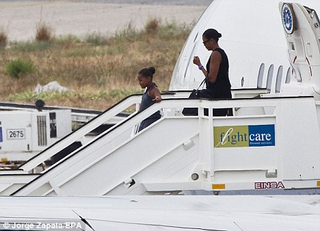 Touch down: Michelle and Sasha Obama arrive at Malaga airport on Air Force Two