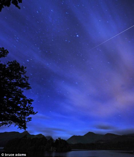The annual Perseids meteor shower ) at Friars Crag, Derwentwater, Keswick, Cumbria in 2008. Astronomers predict this year will be the best display yet