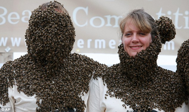 Bee bonding: Tibor Szabo reaches his arm around fellow competitor Christy Hiemstra of Alymer