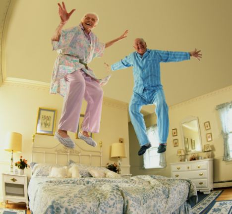 Old couple jumping