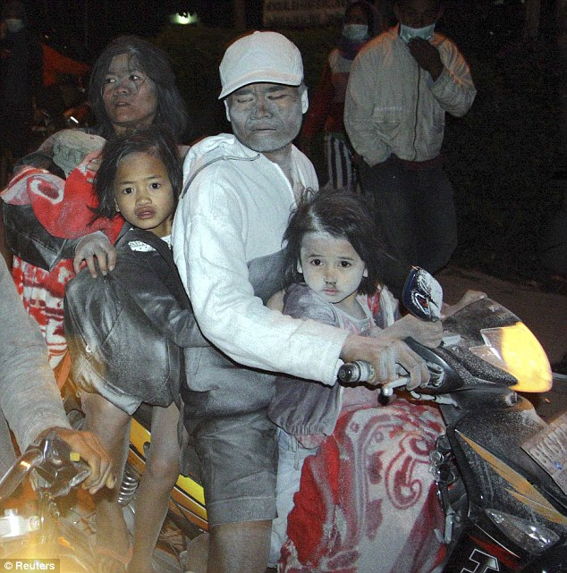 Indonesia Volcano Ash Covered Villagers Flee With Their