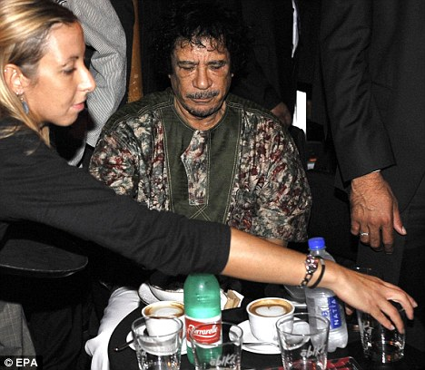 Conversion: Gaddafi enjoys a coffee in Campo de' Fiori square  before hosting the party at the Libyan Academy