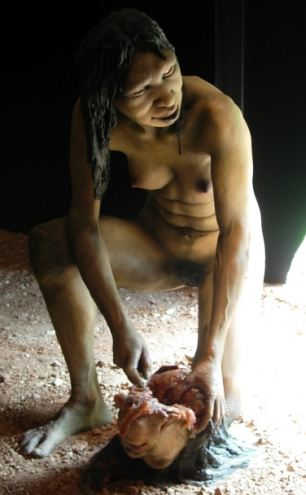 A model of a homo antecessor female scooping out the brains of human head