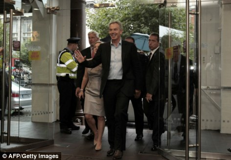 Put-off: Mr Blair arrived at the book signing in Dublin flanked by security but says he does not want to waste police time and money so may not go ahead with his signing on Wednesday