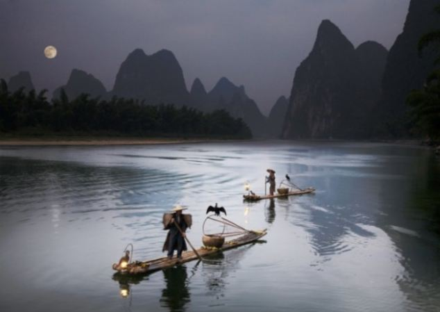 Alastair Swan captured the magical evening light on Li River in China's Guangxi Province as fishermen plied their trade with the help of specially trained cormorants.