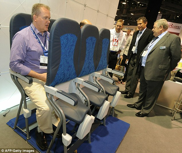Standing seating: Airline industry insiders try out the Skyride at  its debut in America