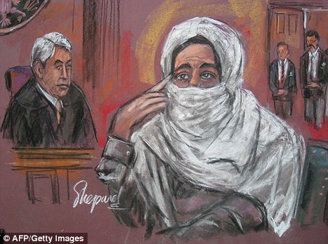 Jailed for 86 years: Pakistani scientist Aafia Siddiqui with Judge Richard Berman in New York today as she was sentenced