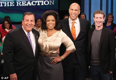 Mark Zuckerberg (far right) poses with Oprah Winfrey, New Jersey Governor Chris Christie (left) and Mayor Cory Booker